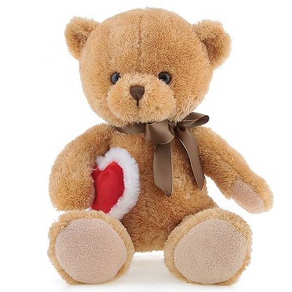Teddy bear holding heart